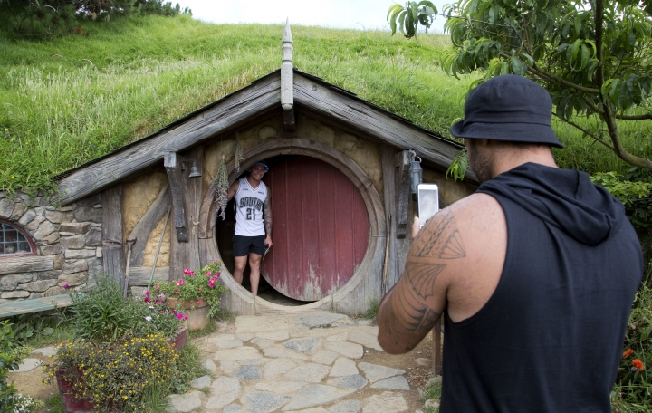 FILE - In this Dec. 31, 2015, file photo, tourists take photos during a tour of the Hobbit movie set near Matamata, New Zealand. (AP Photo/Mark Baker, File)