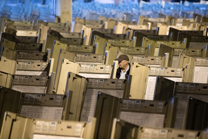 """FILE- In this Oct. 14, 2016, file photo, a technician works to prepare voting machines to be used in the upcoming presidential election, in Philadelphia. Since last July, a bipartisan team at Harvard, including former U.S. Marine and Army cyberwarriors, national security eggheads and Google engineers, has been looking into how to safeguard the vote against interference. The group drafted its latest protect-the-vote election """"playbooks"""" intended to prepare state and local officials for the worst. (AP Photo/Matt Rourke, File)"""