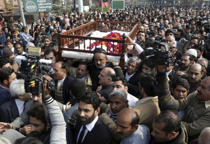 People attend the funeral of Pakistani human rights activist Asma Jahangir in Lahore, Pakistan, Tuesday, Feb. 13, 2018. Pakistan has bid farewell to rest one of the country's most prominent human rights activists, Jahangir, who died this week of a heart attack in the eastern city of Lahore. (AP Photo/K.M. Chaudary)