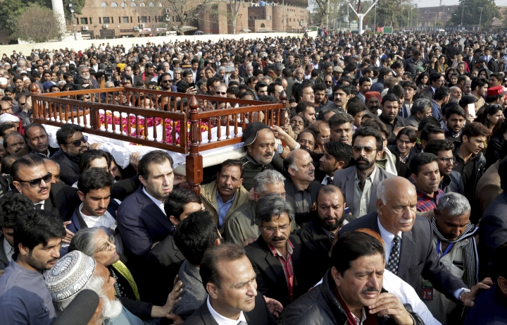People attend the funeral of a prominent lawyer Asma Jahangir in Lahore, Pakistan, Tuesday, Feb. 13, 2018. Pakistan has bid farewell to rest one of the country's most prominent human rights activists, Jahangir, who died this week of a heart attack in the eastern city of Lahore. (AP Photo/K.M. Chaudary)