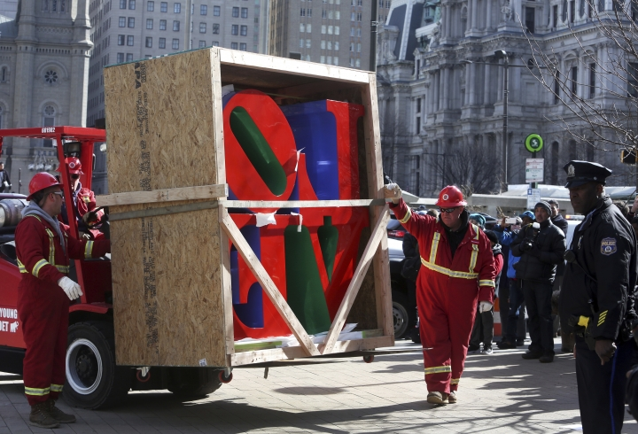 """LOVE"", the famous 1976 Robert Indiana sculpture, is moved from a truck to a pedestal during reinstallation in John F. Kennedy Plaza, Tuesday Feb. 13, 2018 in Philadelphia. The sculpture was removed for repairs a year ago while its home, the downtown park, was going through a renovation. (AP Photo/Jacqueline Larma)"