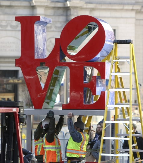 """LOVE"", the famous 1976 Robert Indiana sculpture, is situated onto a pedestal during reinstallation in John F. Kennedy Plaza, Tuesday Feb. 13, 2018 in Philadelphia. The sculpture was removed for repairs a year ago while its home, the downtown park, was going through a renovation. (AP Photo/Jacqueline Larma)"