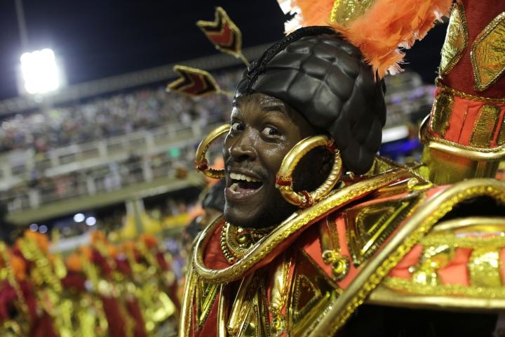 A performer from the Salgueiro samba school parades during Carnival celebrations at the Sambadrome in Rio de Janeiro, Brazil, early Tuesday, Feb. 13, 2018. (AP Photo/Silvia Izquierdo)