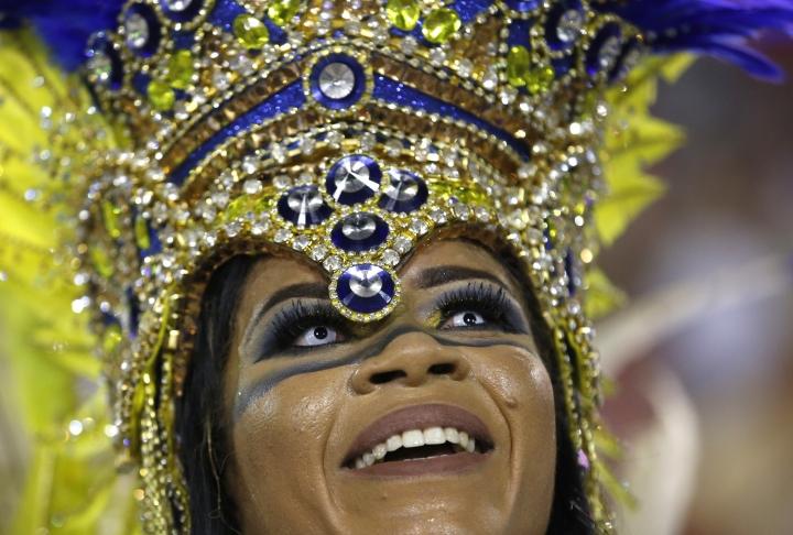 A performer from the Uniao da Ilha samba school parades during Carnival celebrations at the Sambadrome in Rio de Janeiro, Brazil, early Tuesday, Feb. 13, 2018. (AP Photo/Silvia Izquierdo)