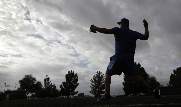 Kansas City Royals pitcher Wily Peralta warms up during a baseball spring training workout, Tuesday, Feb. 13, 2018, in Surprise, Ariz. (AP Photo/Charlie Neibergall)