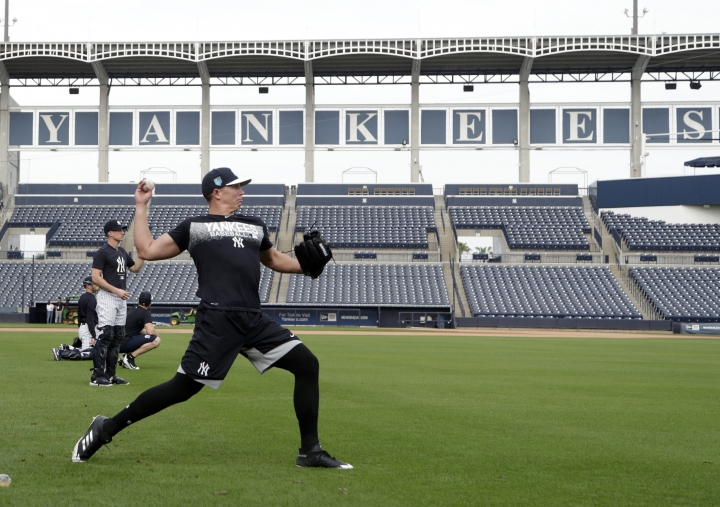 New York Yankees relief pitcher Chad Green throws during baseball spring training, Tuesday, Feb. 13, 2018, in Tampa, Fla. (AP Photo/Lynne Sladky)