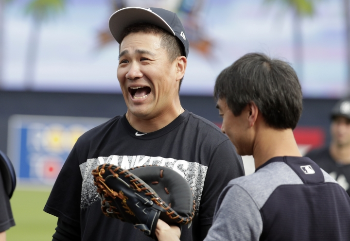 New York Yankees starting pitcher Masahiro Tanaka, of Japan, laughs as he works out during baseball spring training, Tuesday, Feb. 13, 2018, in Tampa, Fla. (AP Photo/Lynne Sladky)