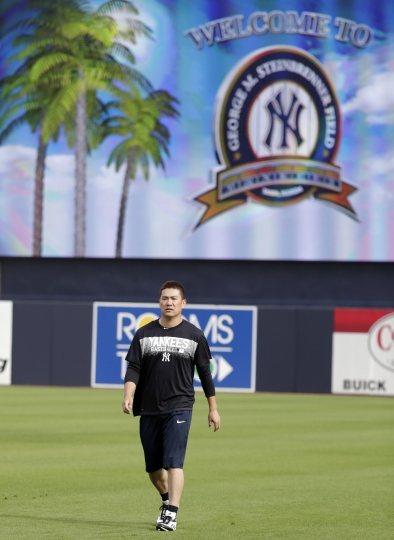 New York Yankees starting pitcher Masahiro Tanaka, of Japan, works out on the field during baseball spring training, Tuesday, Feb. 13, 2018, in Tampa, Fla. (AP Photo/Lynne Sladky)