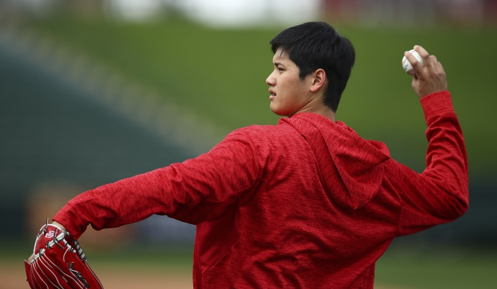 Los Angeles Angels' Shohei Ohtani throws during a spring training practice on Tuesday, Feb. 13, 2018, in Tempe, Ariz. (AP Photo/Ben Margot)