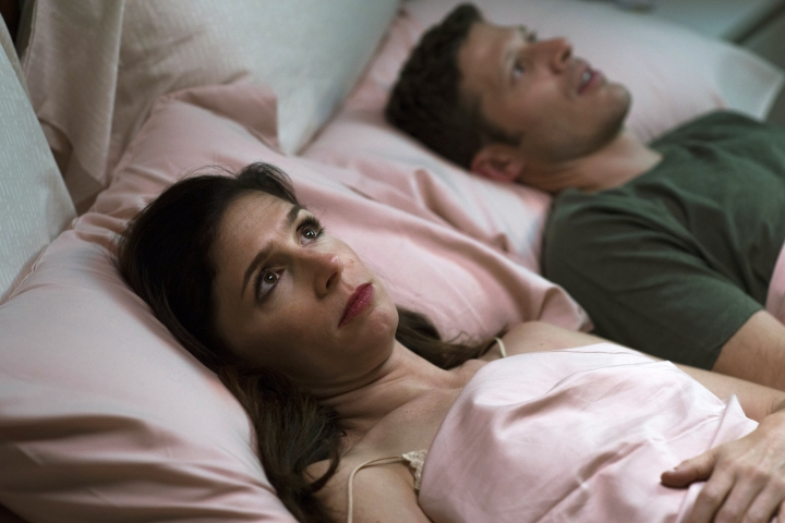 """This image released by Sundance Now shows Shoshannah Stern, left, and Zach Gilford in a scene from """"This Close,"""" a series premiering Feb. 14 on Sundance Now. (Gunther Campine/Sundance Now via AP)"""