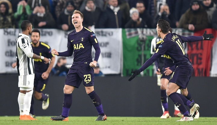 Tottenham's Christian Eriksen celebrates after scoring during the Champions League, round of 16 first-leg soccer match between Juventus and Tottenham Hotspurs, at the Allianz Stadium in Turin, Italy, Tuesday, Feb. 13, 2018. (Alessandro Di Marco/ANSA via AP)