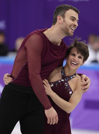 Meagan Duhamel and Eric Radford of Canada react after their performance in the team event pair skating in the Gangneung Ice Arena at the 2018 Winter Olympics in Gangneung, South Korea, Sunday, Feb. 11, 2018. (AP Photo/Julie Jacobson)