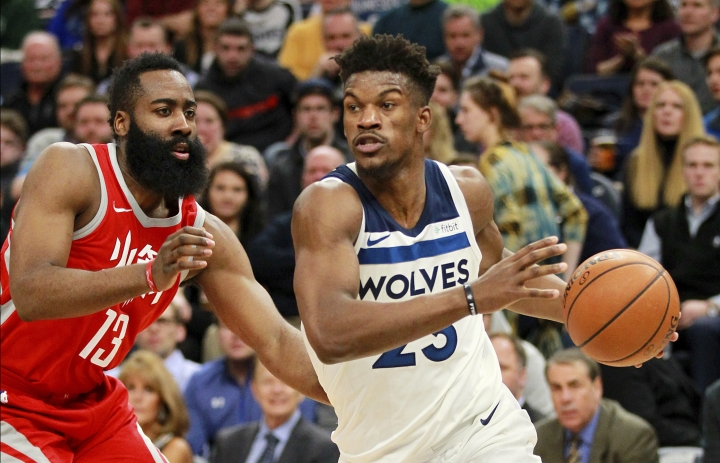 Minnesota Timberwolves' Jimmy Butler (23) drives on Houston Rockets guard James Harden (13) during the second quarter of an NBA basketball game Tuesday, Feb. 13, 2018 in Minneapolis. (AP Photo/Andy Clayton-King)