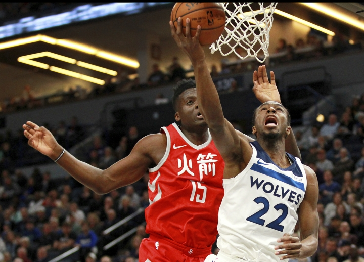 Minnesota Timberwolves forward Andrew Wiggins (22) shoots in front of Houston Rockets' Clint Capela (15) during the first quarter of an NBA basketball game Tuesday, Feb. 13, 2018, in Minneapolis. (AP Photo/Andy Clayton-King)