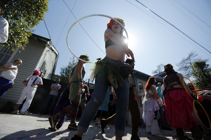 A reveler twirls a hula hoop during the Society de Sainte Anne parade, on Mardi Gras day in New Orleans, Tuesday, Feb. 13, 2018. (AP Photo/Gerald Herbert)