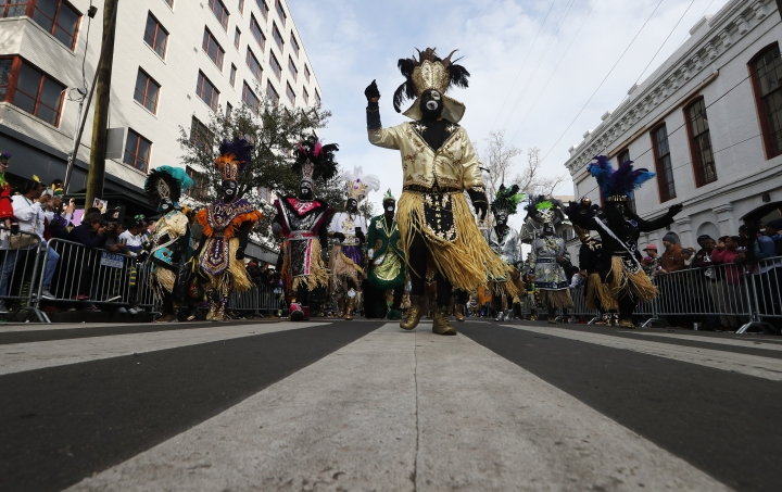 Members of the Krewe of Zulu march as their parade rolls on Mardi Gras day in New Orleans, Tuesday, Feb. 13, 2018. (AP Photo/Gerald Herbert)