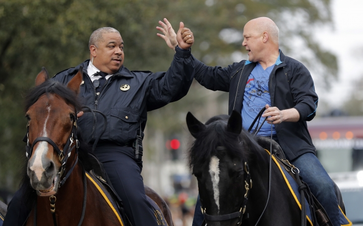 New Orleans Mayor Mitch Landrieu, right, and chief of police Michael Harrison ride on horseback at the start of the Krewe of Zulu parade on Mardi Gras day in New Orleans, Tuesday, Feb. 13, 2018. (AP Photo/Gerald Herbert)