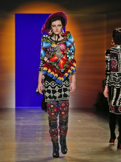 Fashion from Naeem Khan is modeled during Fashion Week, Tuesday Feb. 13, 2018, in New York. (AP Photo/Bebeto Matthews)