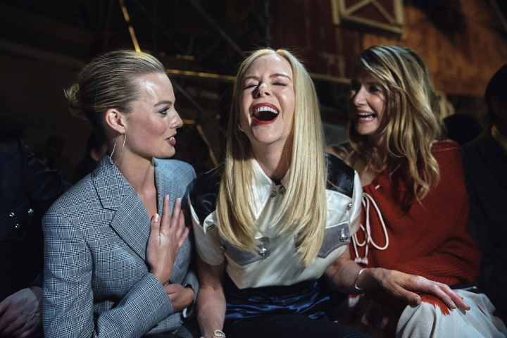 Margot Robbie, left, Nicole Kidman, center, and Laura Dern, right, laugh during the Calvin Klein fashion show at the Fashion Week in New York, Tuesday, Feb. 13, 2018. (AP Photo/Andres Kudacki)