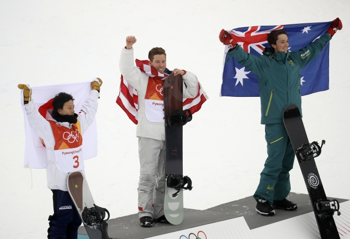From left; Silver medal winner Ayumu Hirano, of Japan, gold medal winner Shaun White, of the United States, and bronze medal winner Scotty James, of Australia, celebrate after the men's halfpipe finals at Phoenix Snow Park at the 2018 Winter Olympics in Pyeongchang, South Korea, Wednesday, Feb. 14, 2018(AP Photo/Kin Cheung)