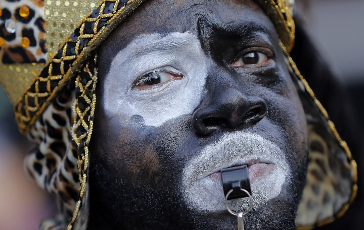 A member of the Krewe of Zulu leads the way as their parade rolls on Mardi Gras day in New Orleans, Tuesday, Feb. 13, 2018. (AP Photo/Gerald Herbert)
