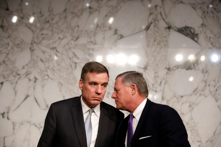 Sen. Mark Warner (D-VA) speaks with Sen. Richard Burr (R-NC) after a hearing of the Senate Intelligence Committee on Capitol Hill in Washington, U.S., February 13, 2018. REUTERS/Aaron P. Bernstein??