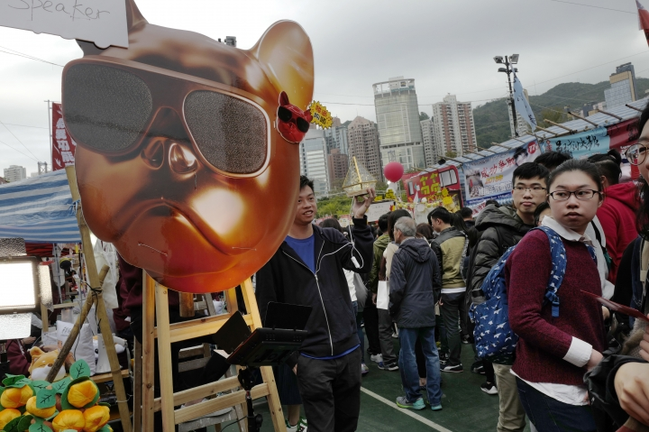 People walk past dog-themed products at a New Year market in Hong Kong's Victoria Park Wednesday, Feb. 14, 2018. Chinese will celebrate the Lunar New Year on Feb. 16 this year which marks the Year of the Dog in the Chinese zodiac. (AP Photo/Vincent Yu)