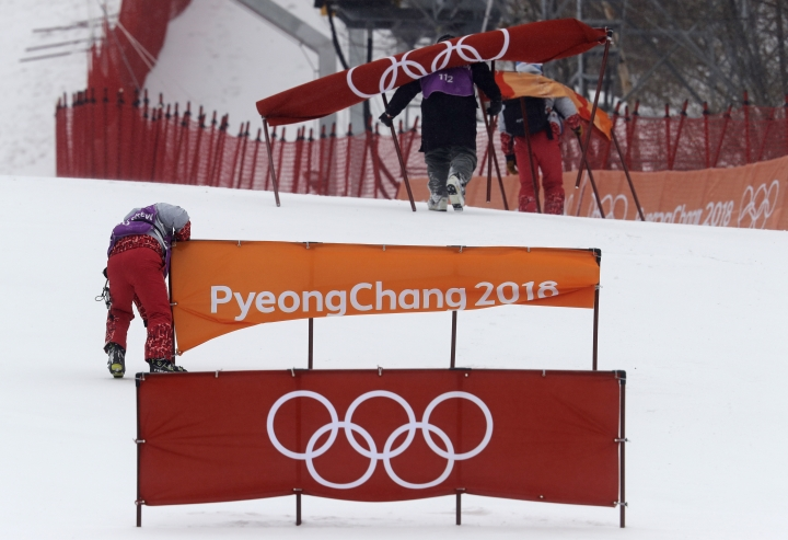 Members of the course crew dismantle it after the women's slalom was canceled for the day due to weather at Yongpyong alpine center at the 2018 Winter Olympics in Pyeongchang, South Korea, Wednesday, Feb. 14, 2018. (AP Photo/Michael Probst)
