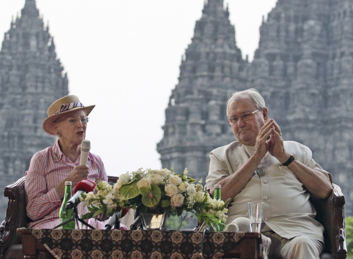 FILE - In this Oct. 24, 2015, file photo, Denmark's Queen Margrethe II speaks to the media as her husband Prince Henrik listens during their visit at the 9th-century Prambanan Temple in Yogyakarta, Indonesia. Prince Henrik, the French-born husband of Danish monarch Queen Margrethe who publicly vented his frustration at not being the social equal of his wife or their son in line to become Denmark's king, died late Tuesday, Feb. 13, 2018. He was 83. (AP Photo/File)