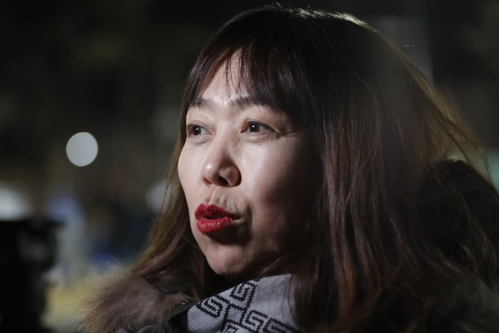 In a photo taken Monday, Feb. 12, 2018, Woo Hee-jun, mother of South Korean player Han Dohee, talks to The Associated Press while arriving at the Kwandong Hockey Center to watch her daughter play for the Koreas during a women's hockey game against Sweden at the 2018 Winter Olympics in Gangneung, South Korea. Parents of players at Koreas' joint women's hockey team say they are so proud of their daughters for creating history in inter-Korean relations. (AP Photo/Julio Cortez)