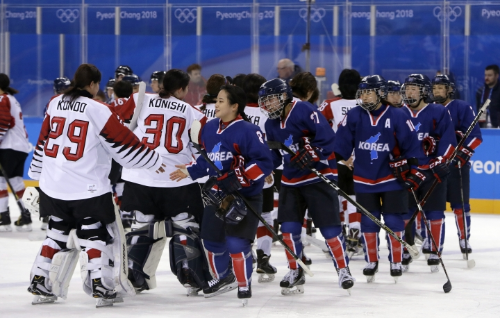 Players greet each other after the preliminary round of the women's hockey game between Japan and the combined Koreas at the 2018 Winter Olympics in Gangneung, South Korea, Wednesday, Feb. 14, 2018. Japan won 4-1. (AP Photo/Matt Slocum)