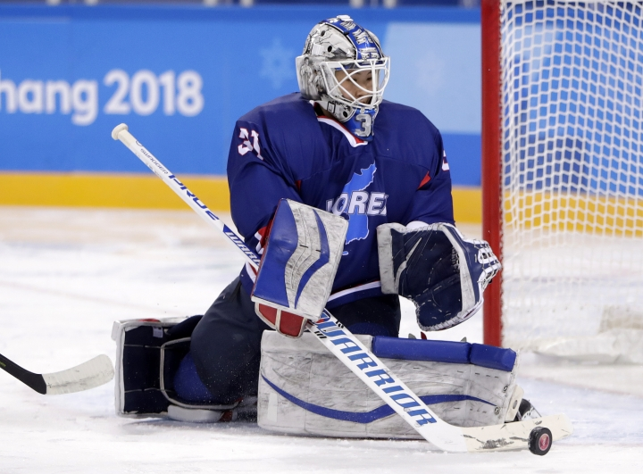 South Korea's goalie Shin So-jung (31), of the combined Koreas team, deflects the puck during the second period of the preliminary round of the women's hockey game against Sweden at the 2018 Winter Olympics in Gangneung, South Korea, Monday, Feb. 12, 2018. (AP Photo/Julio Cortez)