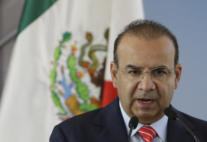 Mexico's Interior Secretary Alfonso Navarrete speaks during the groundbreaking ceremony for the new U.S. embassy, in Mexico City, Tuesday, Feb. 13, 2018. Navarrete told local media that the federal intelligence agency sent a plainclothes agent to tail an opposition presidential candidate, even though the candidate never asked for and apparently did not want a tail. (AP Photo/Rebecca Blackwell)