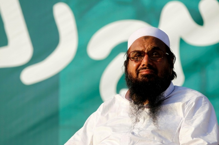 "FILE PHOTO: Hafiz Muhammad Saeed, chief of the banned Islamic charity Jamat-ud-Dawa, looks over the crowed as they end a ""Kashmir Caravan"" from Lahore with a protest in Islamabad, Pakistan July 20, 2016. REUTERS/Caren Firouz/File Photo"