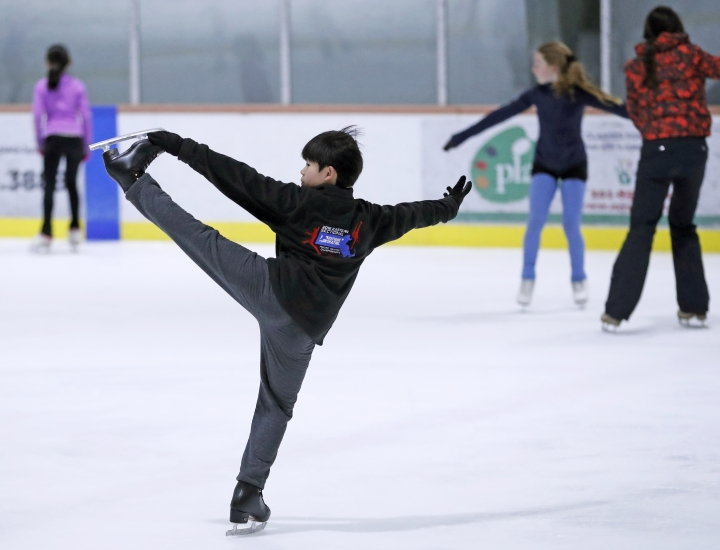 "Keita Horiko, center, the 10-year-old U.S. Figure Skating juvenile boys champion, practices for his new routine Thursday, Feb. 8, 2018, at the Ice House in Hackensack, N.J. ""It's very inspiring and it makes you think, I want to be like them,"" Keita said of the Asian-Americans competing on the U.S. team in Olympic figure skating. (AP Photo/Kathy Willens)"