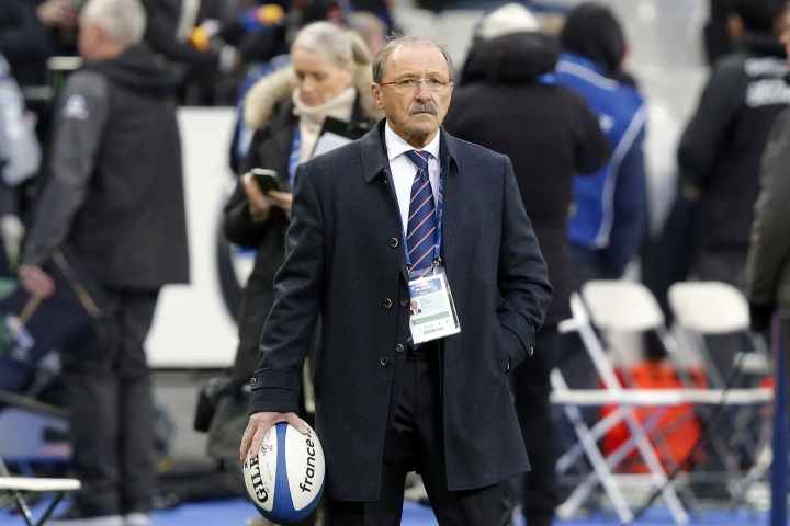 FILE - In this file photo dated Saturday, Feb. 3, 2018, France's rugby coach Jacques Brunel watches his players prior to the Six Nations rugby union match between France and Ireland at the Stade de France stadium in Saint-Denis, outside Paris, France. Brunel had already excluded some players for disciplinary reasons, and Wednesday Feb. 14, 2018, French rugby federation opened an investigation that could lead to further sanctions for the players who allegedly went out drinking on Sunday after losing to hosts Scotland in the Six Nations tournament. (AP Photo/Michel Euler, FILE)