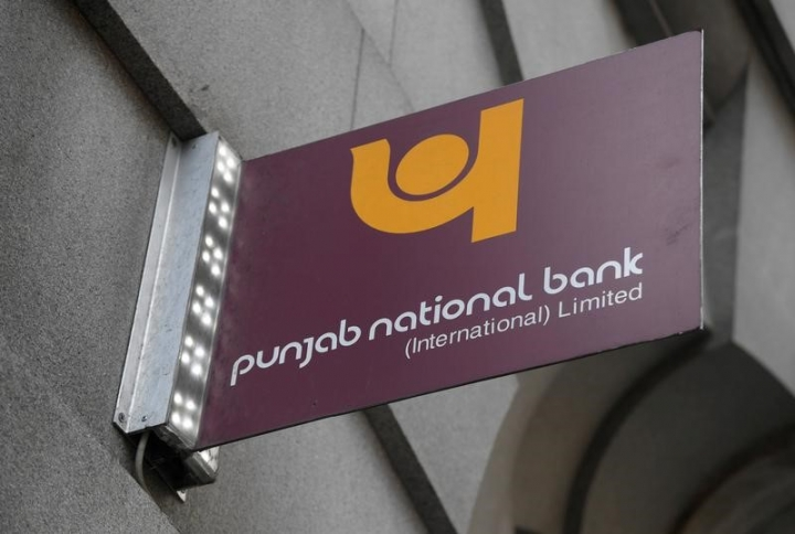 FILE PHOTO: The logo of Punjab National Bank is seen outside of a branch of the bank in the City of London financial district in London September 4, 2017. REUTERS/Toby Melville/File Photo