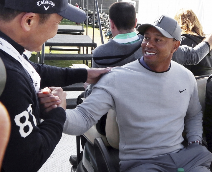 Tiger Woods greets a wellwisher after a news conference where he talked about his charitable works off the course and his return to competitive golf in the Genesis Open at Riviera Country Club after an absence of 12 years, at the course in the Pacific Palisades area of Los Angeles Tuesday, Feb. 13, 2018. (AP Photo/Reed Saxon)
