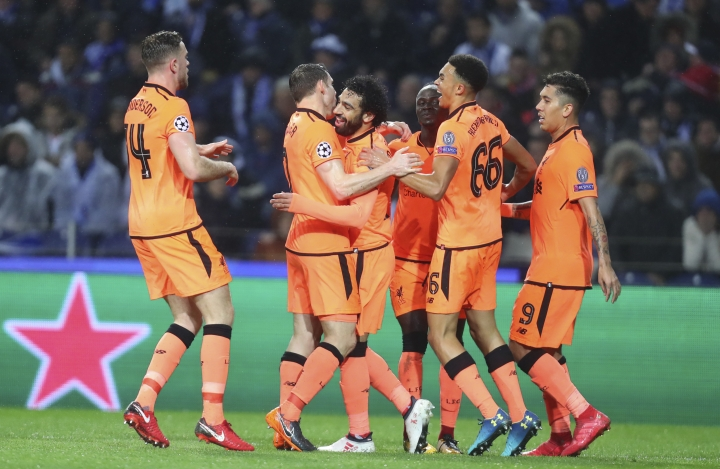 Liverpool's Mohamed Salah, 3rd left, celebrates after scoring his side's second goal during the Champions League round of sixteen first leg soccer match between FC Porto and Liverpool FC at the Dragao stadium in Porto, Portugal, Wednesday, Feb. 14, 2018. (AP Photo/Luis Vieira)
