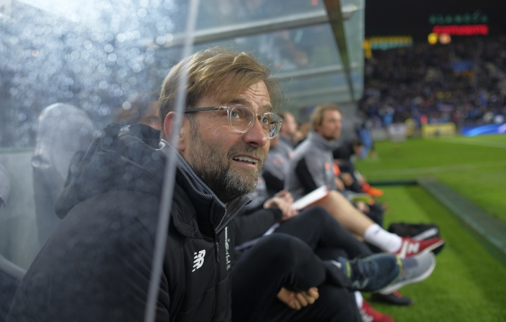 Liverpool coach Jurgen Klopp sits on the bench during the Champions League round of sixteen first leg soccer match between FC Porto and Liverpool FC at the Dragao stadium in Porto, Portugal, Wednesday, Feb. 14, 2018. (AP Photo/Luis Vieira)