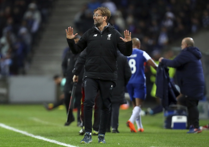 Liverpool coach Jurgen Klopp gestures during the Champions League round of sixteen first leg soccer match between FC Porto and Liverpool FC at the Dragao stadium in Porto, Portugal, Wednesday, Feb. 14, 2018. (AP Photo/Luis Vieira)