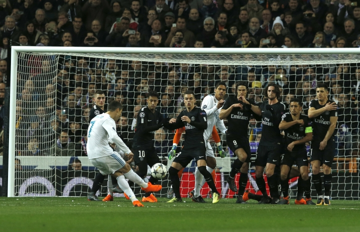 Real Madrid's Cristiano Ronaldo shoots a foul against Paris Saint Germain during the Champions League soccer match, round of 16, 1st leg between Real Madrid and Paris Saint Germain at the Santiago Bernabeu stadium in Madrid, Spain, Wednesday, Feb. 14, 2018. (AP Photo/Paul White)