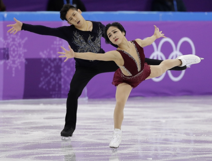 Sui Wenjing and Han Cong of China perform in the pair figure skating short program in the Gangneung Ice Arena at the 2018 Winter Olympics in Gangneung, South Korea, Wednesday, Feb. 14, 2018. (AP Photo/David J. Phillip)