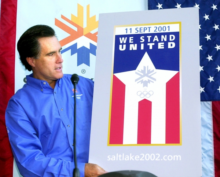 "FILE - In this Sept. 17, 2001, file photo, shows Mitt Romney, president of the Salt Lake Organizing Committee, with the new Olympic ""We Stand United"" pin during a news conference, in Salt Lake City. Romney's run for U.S. Senate in Utah is his latest bid for public office since he first jumped into politics more than 20 years ago. (AP Photo/Douglas C. Pizac, File)"