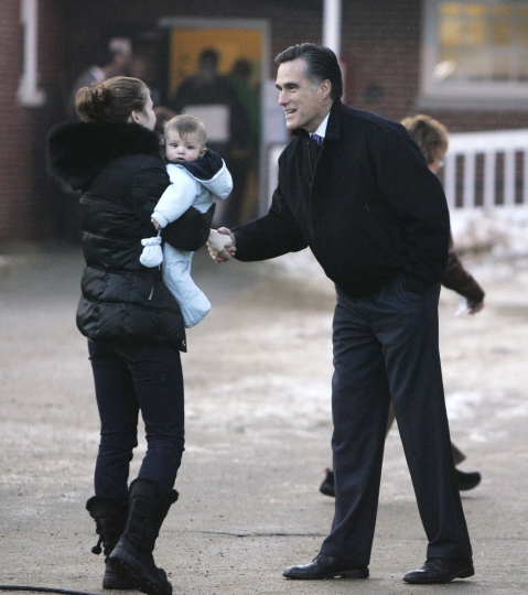 FILE - In this Jan. 8, 2008, file photo, Republican Presidential hopeful, former Massachusetts Gov. Mitt Romney greets a voter heading to the polls at Brookside Congregational Church to vote in the New Hampshire Presidential Primary in Manchester, N.H. Romney's announcement Thursday, Feb. 15, 2018, of a run for U.S. Senate seat in Utah is his latest bid for public office since he first jumped into politics more than 20 years ago. (AP Photo/LM Otero, File)