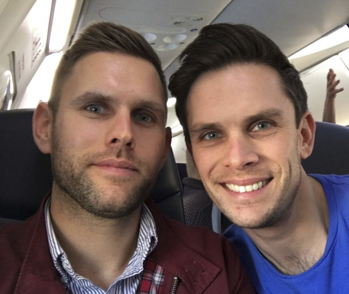 This is an undated family handout photo issued by Britain's Foreign & Commonwealth Office and made available on Tuesday Feb. 13, 2018 of Stuart Hill, left, and his brother Jason Hill, who both died in a Grand Canyon helicopter crash. An expert says investigators are likely to pay special attention to the type of helicopter that crashed in the Grand Canyon, killing three British tourists. Aviation attorney Gary C. Robb says the EC-130 helicopter generally lacks a system to keep it from exploding on impact, denying passengers a few extra minutes to try to escape. It comes after the crash on tribal land, which has fewer regulations than helicopter tours in Grand Canyon National Park. (Family Handout Foreign & Commonwealth Office via AP)