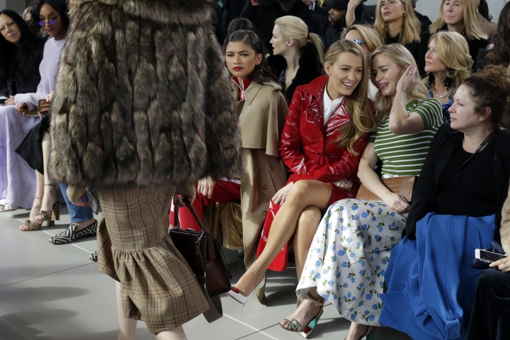 Blake Lively, third from right and Emily Blunt, second from right, talk as the Michael Kors collection is shown during Fashion Week in New York, Wednesday, Feb. 14, 2018. (AP Photo/Richard Drew)