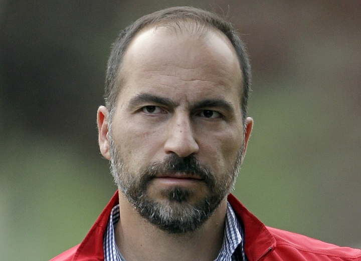 FILE - In this July 13, 2012, file photo, Expedia CEO Dara Khosrowshahi attends the Allen & Company Sun Valley Conference in Sun Valley, Idaho. Ride-hailing giant Uber's full-year net loss widened to $4.5 billion in 2017. The results also showed that Uber cut its fourth-quarter net loss by 25 percent from the third quarter as new CEO Khosrowshahi moves to make the company profitable ahead of a planned initial public stock offering sometime next year. (AP Photo/Paul Sakuma, File)