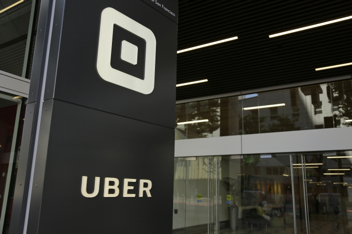 FILE - This June 21, 2017, file photo shows the building that houses the headquarters of Uber, in San Francisco. Ride-hailing giant Uber's full-year net loss widened to $4.5 billion in 2017 as the company endured a tumultuous year that included multiple scandals, a lawsuit alleging the theft of trade secrets and the replacement of its CEO. A person briefed on the results provided some numbers and confirmed the accuracy of The Information's story to The Associated Press on Wednesday, Feb. 14, 2018. (AP Photo/Eric Risberg, File)