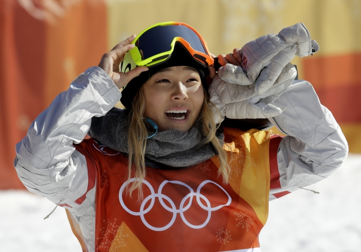 "FILE - In this Tuesday, Feb. 13, 2018 file photo, Chloe Kim, of the United States, smiles during the women's halfpipe finals at Phoenix Snow Park at the 2018 Winter Olympics in Pyeongchang, South Korea. A San Francisco Bay Area radio station has fired one of its hosts, Patrick Connor, after he made sexual comments about 17-year-old Olympic snowboarder Kim on another station. Program director Jeremiah Crowe of KNBR-AM, where Connor hosted ""The Shower Hour,"" confirmed the firing Wednesday, Feb. 14, 2018, for NBC Bay Area. (AP Photo/Lee Jin-man, File)"